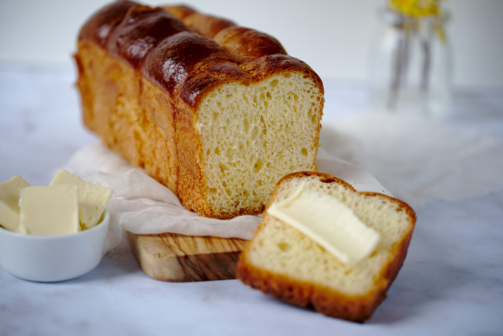Photo of loaf of brioche with butter