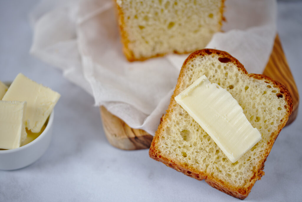close up photo of french brioche with butter
