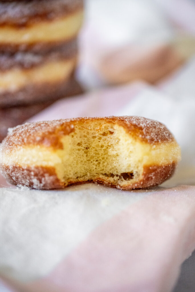 bite picture of sugar tossed doughnuts